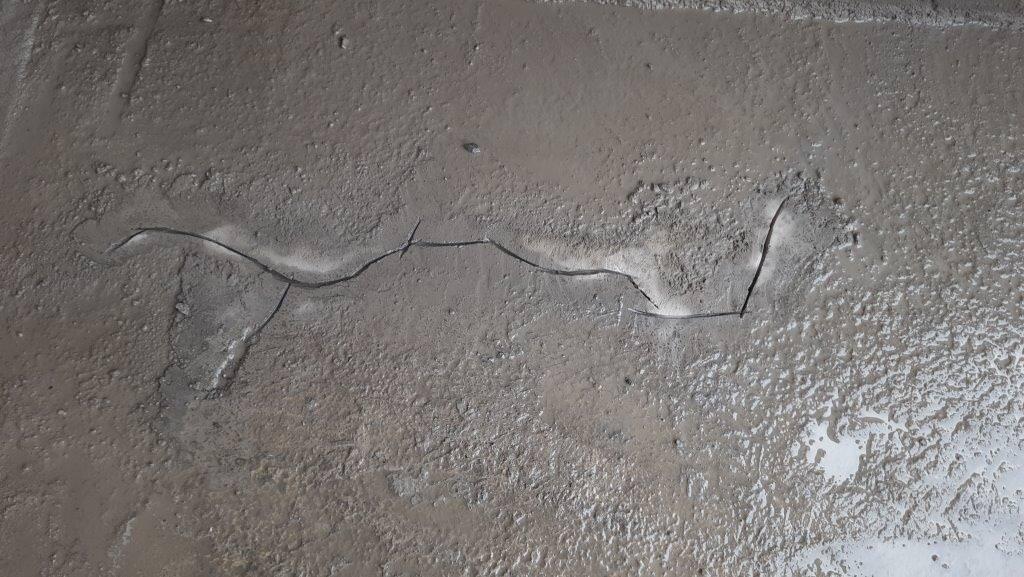 Crack grinded on slab surface.jpg